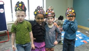 Kids wearing hats at a Story Time program @ Northville Disrict Library