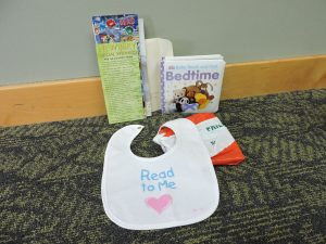 Images of books and a bib for Read to Me Program @ Northville District Library